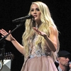 1200px-Carrie_Underwood2C_Grand_Ole_Opry_House2C_Nashville2C_TN2C_June_2018.jpg