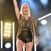 14543250-7119789-Triumphant_Carrie_Underwood_performed_her_longest_set_since_a_dr-m-1_1560025211279.jpg