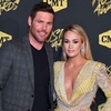 1806071657-Carrie-Underwood-Kisses-Husband-Mike-Fisher-After-Winning.jpg