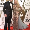 5190023-mike-fisher-et-carrie-underwood-assisten-950x0-2~0.jpg