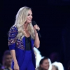 carrie-underwood-standing-on-a-stage-in-front-of-a-crowd-carrie-underwood-cma-awards__691512_.jpg