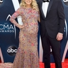 rs_634x1024-181114160907-634-carrie-underwood-mike-fisher-cma-me-111418.jpg